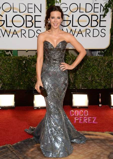 "Kate Beckinsale looks stunning in this mermaid sparkler. I love this look. It reminds me of the ""armor"" style dress Naomi Watts wore to the Oscar's last year. I think everything about her look really works well together."