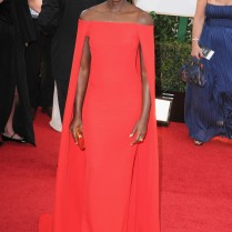 Lupita Nyong'o in Ralph Lauren... She is a true STATEMENT MAKER! This dress is a total knockout. The cape and the color are such a risk but I think she pulled it off beautifully because she kept everything else about her look simple. Well done!