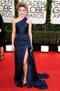 Amber Heard looks great in this Angelina-equse gown. I love the high slit and the pleating details. I also didn't see a lot of navy on the carpet so I am glad she did it.